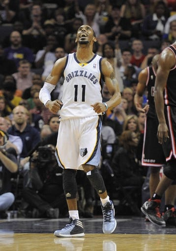 Apr 9, 2014; Memphis, TN, USA; Memphis Grizzlies guard Mike Conley (11) reacts during the game against the Miami Heat at FedExForum. Memphis Grizzlies beat the Miami Heat 107 - 102. Mandatory Credit: Justin Ford-USA TODAY Sports