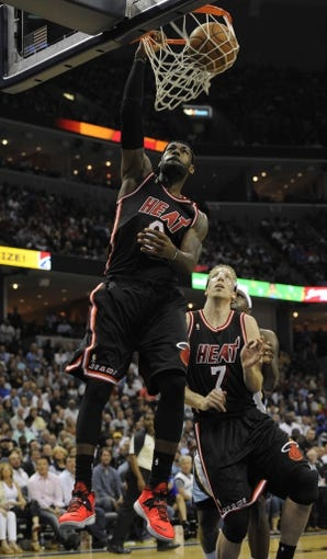 Apr 9, 2014; Memphis, TN, USA; Miami Heat forward LeBron James (6) dunks the ball during the game against the Memphis Grizzlies at FedExForum. Memphis Grizzlies beat the Miami Heat 107 - 102. Mandatory Credit: Justin Ford-USA TODAY Sports