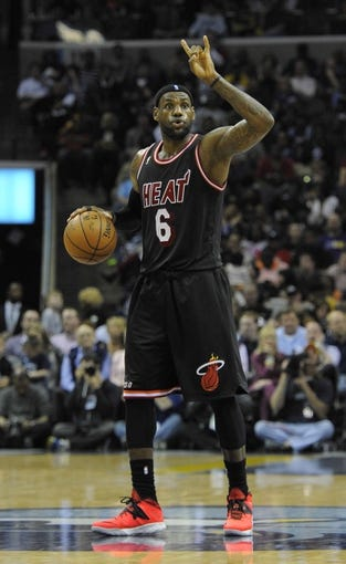 Apr 9, 2014; Memphis, TN, USA; Miami Heat forward LeBron James (6) calls a play during the game against the Memphis Grizzlies at FedExForum. Memphis Grizzlies beat the Miami Heat 107 - 102. Mandatory Credit: Justin Ford-USA TODAY Sports