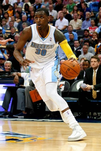 Apr 9, 2014; Denver, CO, USA; Denver Nuggets small forward Quincy Miller (30) controls the ball in the third quarter against the Houston Rockets at the Pepsi Center. The Nuggets won 123-116. Mandatory Credit: Isaiah J. Downing-USA TODAY Sports