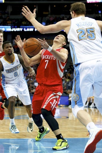 Apr 9, 2014; Denver, CO, USA; Houston Rockets point guard Jeremy Lin (7) is fouled by Denver Nuggets center Timofey Mozgov (25) in the second quarter at the Pepsi Center. Mandatory Credit: Isaiah J. Downing-USA TODAY Sports