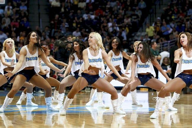 Apr 9, 2014; Denver, CO, USA; Denver Nuggets dancers perform in the fourth quarter of the game against the Houston Rockets at the Pepsi Center. The Nuggets won 123-116. Mandatory Credit: Isaiah J. Downing-USA TODAY Sports