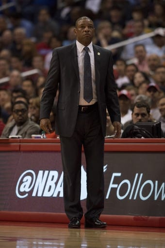 Apr 9, 2014; Los Angeles, CA, USA; Los Angeles Clippers head coach Doc Rivers looks on from the sidelines against the Oklahoma City Thunder during the second quarter at Staples Center. Mandatory Credit: Kelvin Kuo-USA TODAY Sports