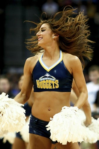 Apr 9, 2014; Denver, CO, USA; A Denver Nuggets dancer performs in the fourth quarter of the game against the Houston Rockets at the Pepsi Center. The Nuggets won 123-116. Mandatory Credit: Isaiah J. Downing-USA TODAY Sports