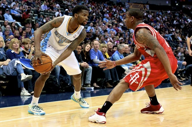 Apr 9, 2014; Denver, CO, USA; Houston Rockets point guard Isaiah Canaan (1) guards Denver Nuggets point guard Aaron Brooks (0) in the fourth quarter at the Pepsi Center. The Nuggets won 123-116. Mandatory Credit: Isaiah J. Downing-USA TODAY Sports