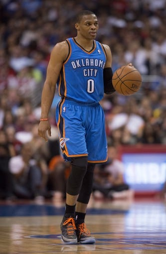 Apr 9, 2014; Los Angeles, CA, USA; Oklahoma City Thunder guard Russell Westbrook (0) dribbles the ball against the Los Angeles Clippers during the second quarter at Staples Center. Mandatory Credit: Kelvin Kuo-USA TODAY Sports