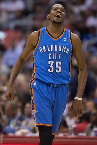 Apr 9, 2014; Los Angeles, CA, USA; Oklahoma City Thunder forward Kevin Durant (35) reacts after scoring against the Los Angeles Clippers during the third quarter at Staples Center. The Thunder won 107-101. Mandatory Credit: Kelvin Kuo-USA TODAY Sports