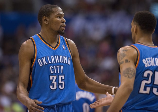 Apr 9, 2014; Los Angeles, CA, USA; Oklahoma City Thunder forward Kevin Durant (35) celebrates with guard Thabo Sefolosha (25) after scoring against the Los Angeles Clippers during the third quarter at Staples Center. The Thunder won 107-101. Mandatory Credit: Kelvin Kuo-USA TODAY Sports