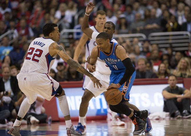Apr 9, 2014; Los Angeles, CA, USA; Oklahoma City Thunder guard Russell Westbrook (0) dribbles the ball as Los Angeles Clippers forward Matt Barnes (22) defends during the fourth quarter at Staples Center. The Thunder won 107-101. Mandatory Credit: Kelvin Kuo-USA TODAY Sports