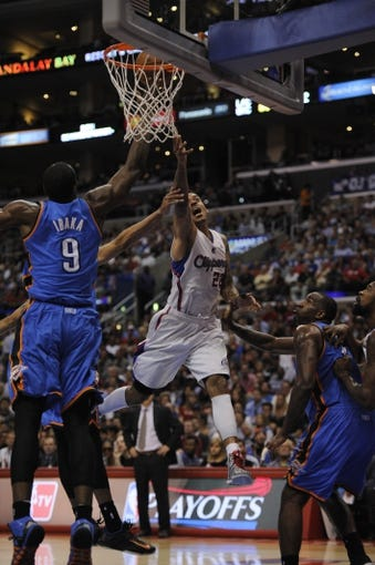 Apr 9, 2014; Los Angeles, CA, USA; Los Angeles Clippers forward Matt Barnes (22) shoots the ball in front of Oklahoma City Thunder forward Serge Ibaka (9) during the third quarter at Staples Center. The Thunder won 107-101. Mandatory Credit: Kelvin Kuo-USA TODAY Sports