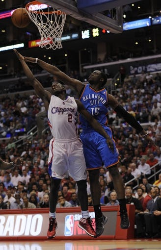 Apr 9, 2014; Los Angeles, CA, USA; Los Angeles Clippers guard Darren Collison (2) shoots the ball as Oklahoma City Thunder guard Reggie Jackson (15) defends during the fourth quarter at Staples Center. The Thunder won 107-101. Mandatory Credit: Kelvin Kuo-USA TODAY Sports