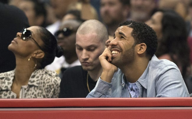 Apr 9, 2014; Los Angeles, CA, USA; Recording Artist Drake (R) smiles during the game between the Oklahoma City Thunder and the Los Angeles Clippers at Staples Center. The Thunder won 107-101. Mandatory Credit: Kelvin Kuo-USA TODAY Sports