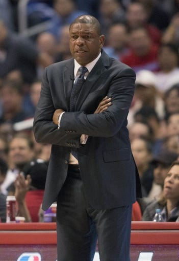 Apr 9, 2014; Los Angeles, CA, USA; Los Angeles Clippers head coach Doc Rivers stands on the sidelines against the Oklahoma City Thunder during the third quarter at Staples Center. The Thunder won 107-101. Mandatory Credit: Kelvin Kuo-USA TODAY Sports