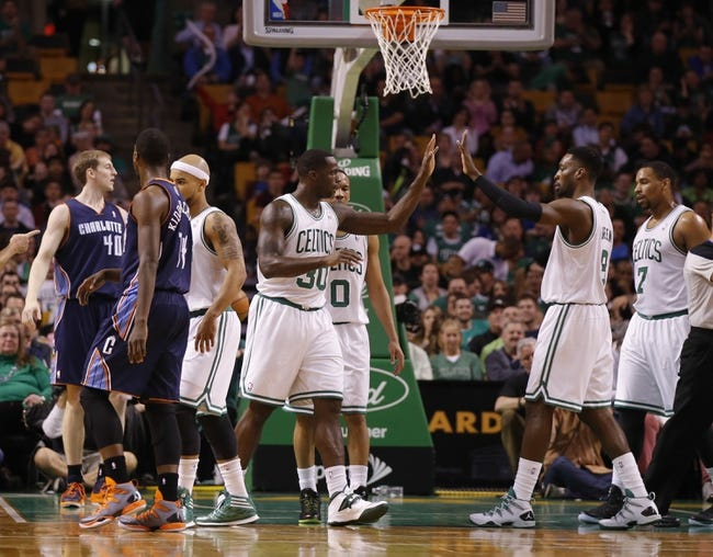 Apr 11, 2014; Boston, MA, USA; Boston Celtics forward Brandon Bass (30) and forward Jeff Green (8) react after a play against the Charlotte Bobcats in the first quarter at TD Garden. Mandatory Credit: David Butler II-USA TODAY Sports