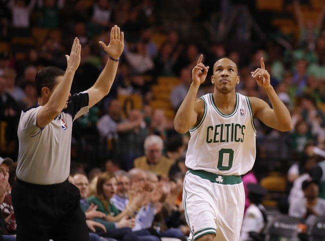 Apr 11, 2014; Boston, MA, USA; Boston Celtics guard Avery Bradley (0) reacts after a three point basket against the Charlotte Bobcats in the first quarter at TD Garden. Mandatory Credit: David Butler II-USA TODAY Sports