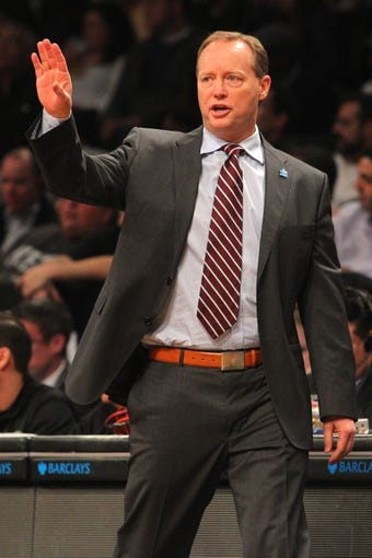 Apr 11, 2014; Brooklyn, NY, USA; Atlanta Hawks head coach Mike Budenholzer coaches against the Brooklyn Nets during the first quarter of a game at Barclays Center. Mandatory Credit: Brad Penner-USA TODAY Sports