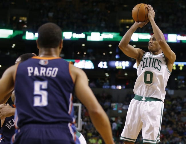 Apr 11, 2014; Boston, MA, USA; Boston Celtics guard Avery Bradley (0) shoots for three points in the second quarter against the Charlotte Bobcats at TD Garden. Mandatory Credit: David Butler II-USA TODAY Sports