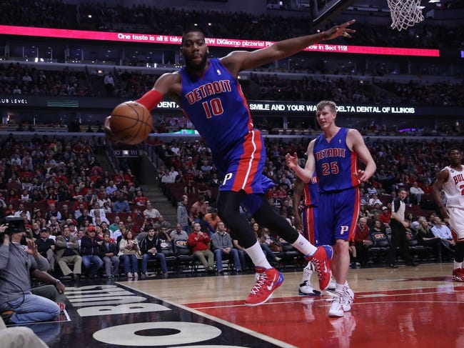 Apr 11, 2014; Chicago, IL, USA; Detroit Pistons forward Greg Monroe (10) saves an out of bounds during the first quarter against the Chicago Bulls at the United Center. Mandatory Credit: Dennis Wierzbicki-USA TODAY Sports