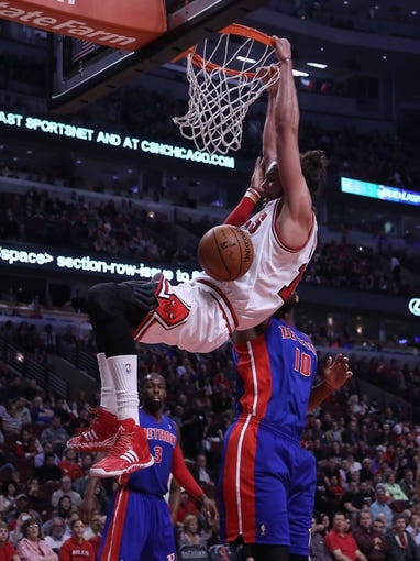 Apr 11, 2014; Chicago, IL, USA; Chicago Bulls center Joakim Noah (13) dunks over Detroit Pistons forward Greg Monroe (10) during the first quarter at the United Center. Mandatory Credit: Dennis Wierzbicki-USA TODAY Sports