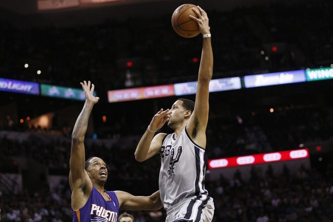 Apr 11, 2014; San Antonio, TX, USA; San Antonio Spurs forward Austin Daye (23) shoots the ball over Phoenix Suns forward Channing Frye (left) during the first half at AT&T Center. Mandatory Credit: Soobum Im-USA TODAY Sports