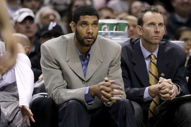 Apr 11, 2014; San Antonio, TX, USA; San Antonio Spurs forward Tim Duncan (21) watches from the bench during the first half against the Phoenix Suns  at AT&T Center. Mandatory Credit: Soobum Im-USA TODAY Sports