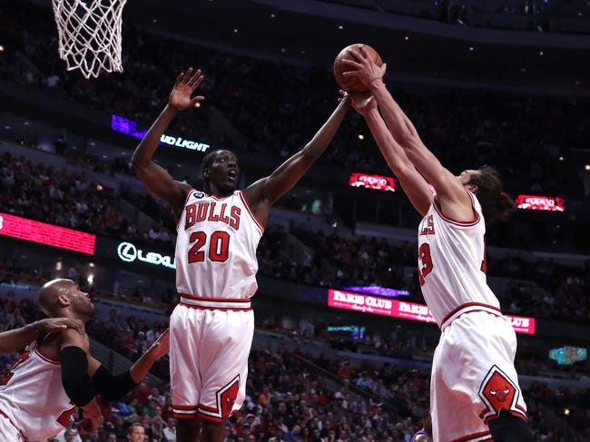 Apr 11, 2014; Chicago, IL, USA; Chicago Bulls guard Tony Snell (20) and center Joakim Noah (13) battle for a rebound during the second quarter against the Detroit Pistons at the United Center. Mandatory Credit: Dennis Wierzbicki-USA TODAY Sports