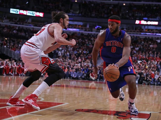 Apr 11, 2014; Chicago, IL, USA; Detroit Pistons center Andre Drummond (0) drives against Chicago Bulls center Joakim Noah (13) during the second quarter at the United Center. Mandatory Credit: Dennis Wierzbicki-USA TODAY Sports