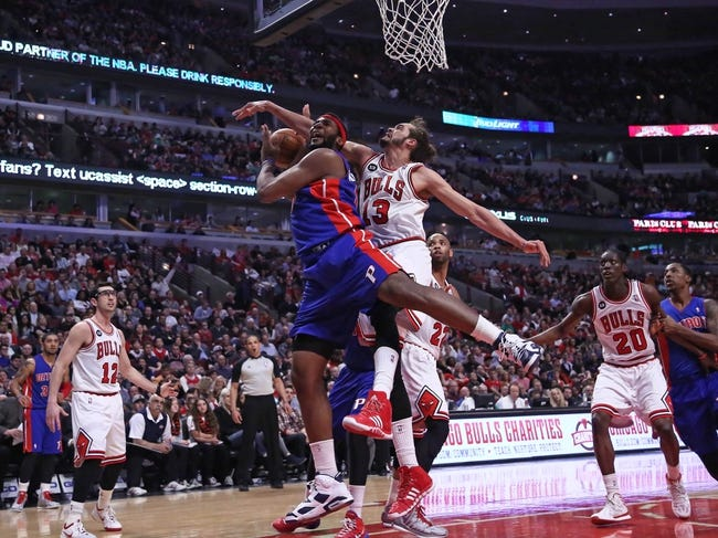 Apr 11, 2014; Chicago, IL, USA; Detroit Pistons center Andre Drummond (0) is fouled by Chicago Bulls center Joakim Noah (13) during the second quarter at the United Center. Mandatory Credit: Dennis Wierzbicki-USA TODAY Sports