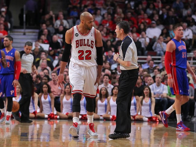 Apr 11, 2014; Chicago, IL, USA; Chicago Bulls forward Taj Gibson (22) argues with referee Scott Foster (48) during the second quarter against the Detroit Pistons at the United Center. Mandatory Credit: Dennis Wierzbicki-USA TODAY Sports