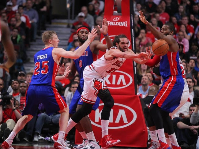 Apr 11, 2014; Chicago, IL, USA; Chicago Bulls center Joakim Noah (13) passes past Detroit Pistons forward Kyle Singler (25) during the second quarter at the United Center. Mandatory Credit: Dennis Wierzbicki-USA TODAY Sports
