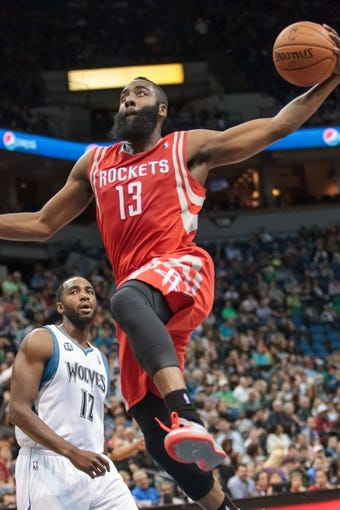 Apr 11, 2014; Minneapolis, MN, USA; Houston Rockets guard James Harden (13) dunks in the second quarter against the Minnesota Timberwolves at Target Center. The basket was called off. Mandatory Credit: Brad Rempel-USA TODAY Sports