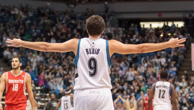 Apr 11, 2014; Minneapolis, MN, USA; Minnesota Timberwolves guard Ricky Rubio (9) signals a three at the end of the half against the Houston Rockets at Target Center. Mandatory Credit: Brad Rempel-USA TODAY Sports