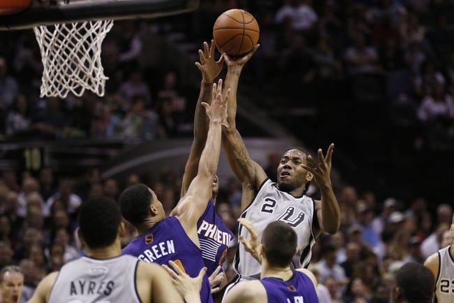 Apr 11, 2014; San Antonio, TX, USA; San Antonio Spurs forward Kawhi Leonard (2) shoots the ball over Phoenix Suns  guard Gerald Green (14) during the first half at AT&T Center. Mandatory Credit: Soobum Im-USA TODAY Sports