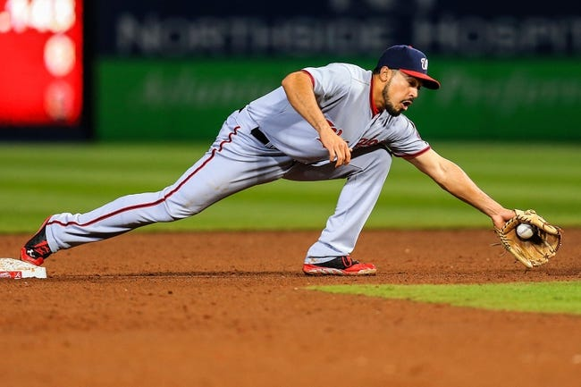 Apr 11, 2014; Atlanta, GA, USA; Washington Nationals second baseman Anthony Rendon (6) stretches for an out in the fifth inning against the Atlanta Braves at Turner Field. Mandatory Credit: Daniel Shirey-USA TODAY Sports