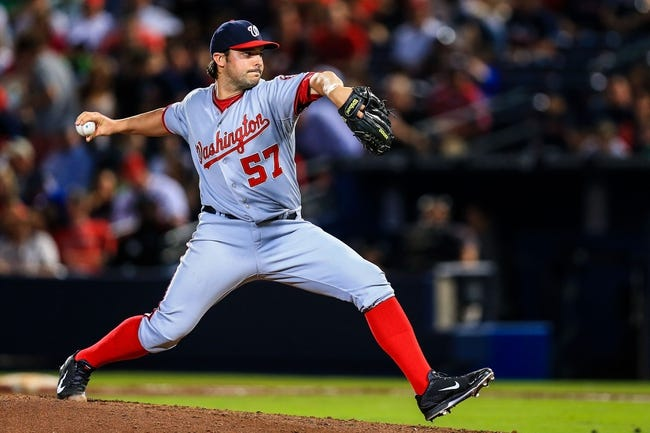 Apr 11, 2014; Atlanta, GA, USA; Washington Nationals starting pitcher Tanner Roark (57) pitches in the fifth inning against the Atlanta Braves at Turner Field. Mandatory Credit: Daniel Shirey-USA TODAY Sports