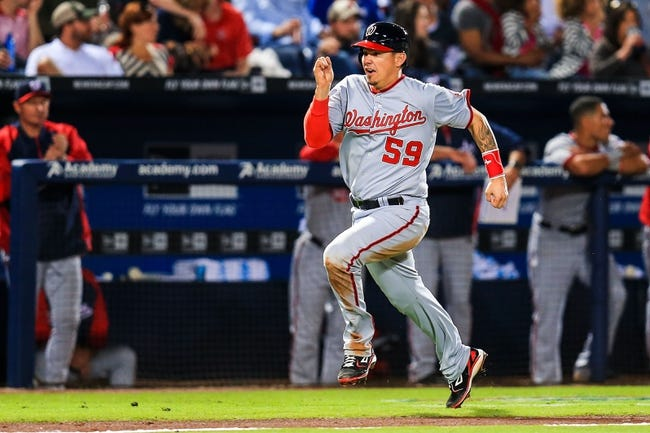 Apr 11, 2014; Atlanta, GA, USA; Washington Nationals catcher Jose Lobaton (59) runs home to score in the sixth inning against the Atlanta Braves at Turner Field. Mandatory Credit: Daniel Shirey-USA TODAY Sports