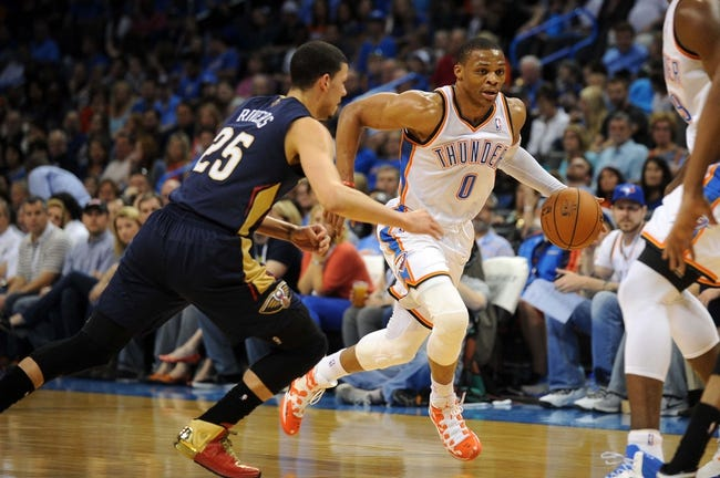 Apr 11, 2014; Oklahoma City, OK, USA; Oklahoma City Thunder guard Russell Westbrook (0) drives to the basket against New Orleans Pelicans guard Austin Rivers (25) during the second quarter  at Chesapeake Energy Arena. Mandatory Credit: Mark D. Smith-USA TODAY Sports