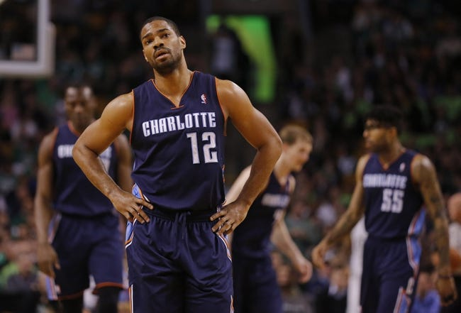 Apr 11, 2014; Boston, MA, USA; Charlotte Bobcats guard Gary Neal (12) and his teammates return up court against the Boston Celtics in the second half at TD Garden. The Celtics defeated the Bobcats 106-103. Mandatory Credit: David Butler II-USA TODAY Sports
