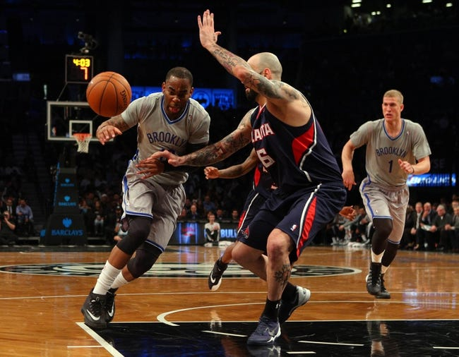 Apr 11, 2014; Brooklyn, NY, USA; Brooklyn Nets shooting guard Marcus Thornton (10) loses the ball while defended by Atlanta Hawks center Pero Antic (6) during the third quarter of a game at Barclays Center. The Hawks defeated the Nets 93-88. Mandatory Credit: Brad Penner-USA TODAY Sports