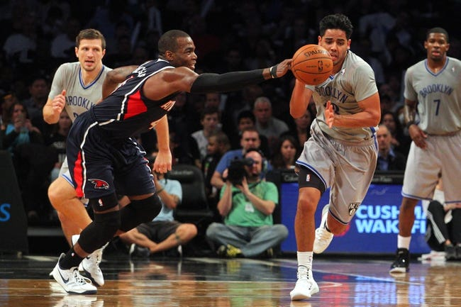 Apr 11, 2014; Brooklyn, NY, USA; Brooklyn Nets point guard Jorge Gutierrez (13) steals the ball from Atlanta Hawks power forward Paul Millsap (4) during the third quarter of a game at Barclays Center. The Hawks defeated the Nets 93-88. Mandatory Credit: Brad Penner-USA TODAY Sports
