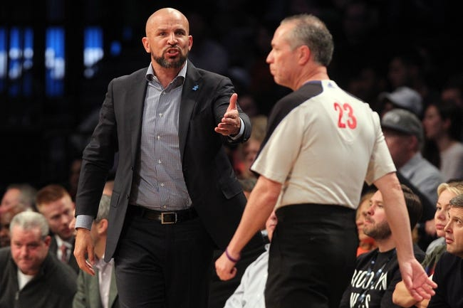 Apr 11, 2014; Brooklyn, NY, USA; Brooklyn Nets head coach Jason Kidd (left) argues an overturned foul call with official Jason Phillips (23) during the fourth quarter of a game against the Atlanta Hawks at Barclays Center. The Hawks defeated the Nets 93-88. Mandatory Credit: Brad Penner-USA TODAY Sports