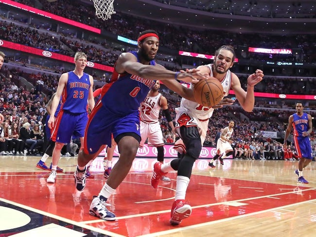 Apr 11, 2014; Chicago, IL, USA; Detroit Pistons center Andre Drummond (0) and Chicago Bulls center Joakim Noah (13) battle for the ball during the second half at the United Center. Chicago won 106-98. Mandatory Credit: Dennis Wierzbicki-USA TODAY Sports