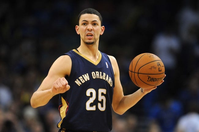Apr 11, 2014; Oklahoma City, OK, USA;  New Orleans Pelicans guard Austin Rivers (25) brings the ball up the courst against the Oklahoma City Thunder during the third quarter at Chesapeake Energy Arena. Mandatory Credit: Mark D. Smith-USA TODAY Sports