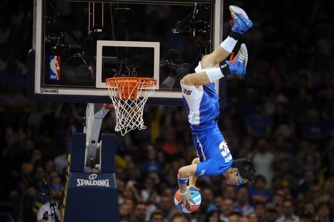 Apr 11, 2014; Oklahoma City, OK, USA; A member of the Oklahoma City Thunder spririt team entertains the fans in a break in action against the New Orleans Pelicans  at Chesapeake Energy Arena. Mandatory Credit: Mark D. Smith-USA TODAY Sports