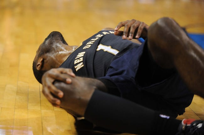 Apr 11, 2014; Oklahoma City, OK, USA;  New Orleans Pelicans forward Tyreke Evans (1) grabs his knee after contact in action against the Oklahoma City Thunder at Chesapeake Energy Arena. Mandatory Credit: Mark D. Smith-USA TODAY Sports