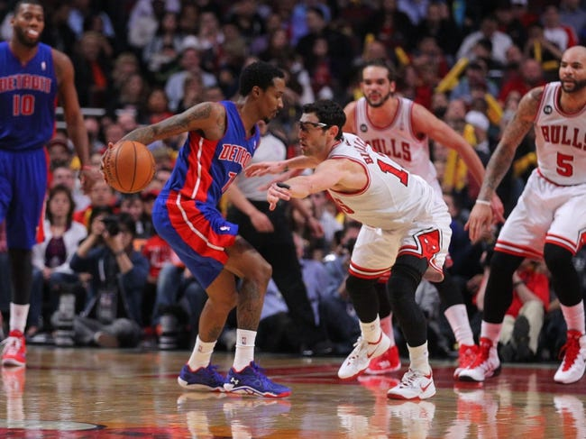 Apr 11, 2014; Chicago, IL, USA; Detroit Pistons guard Brandon Jennings (7) is defended by Chicago Bulls guard Kirk Hinrich (12) during the second half at the United Center. Chicago won 106-98. Mandatory Credit: Dennis Wierzbicki-USA TODAY Sports