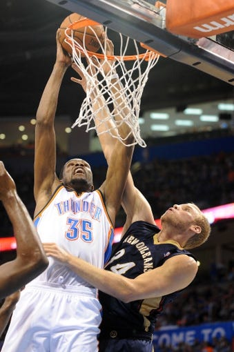 Apr 11, 2014; Oklahoma City, OK, USA; Oklahoma City Thunder forward Kevin Durant (35) dunks the ball against New Orleans Pelicans center Greg Stiemsma (34) during the second quarter  at Chesapeake Energy Arena. Mandatory Credit: Mark D. Smith-USA TODAY Sports