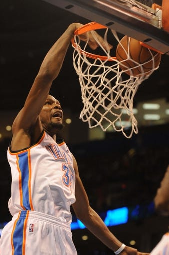 Apr 11, 2014; Oklahoma City, OK, USA; Oklahoma City Thunder forward Kevin Durant (35) dunks the ball against the New Orleans Pelicans during the second quarter  at Chesapeake Energy Arena. Mandatory Credit: Mark D. Smith-USA TODAY Sports