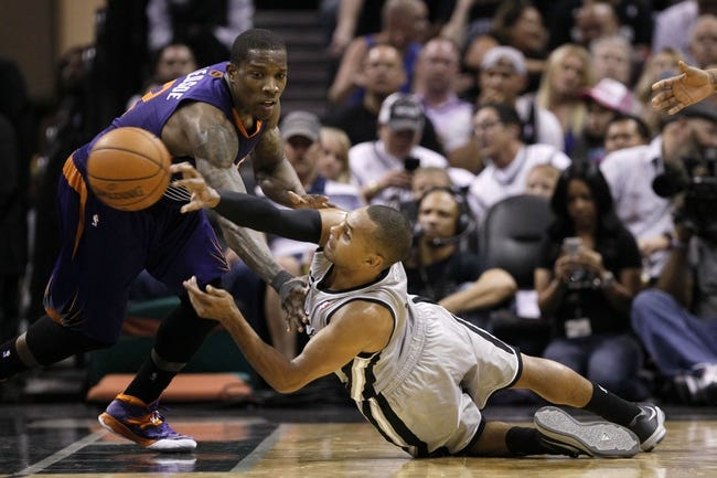 Apr 11, 2014; San Antonio, TX, USA; San Antonio Spurs guard Patrick Mills (8) and Phoenix Suns  guard Eric Bledsoe (left) dive for a loose ball during the second half at AT&T Center. The Spurs won 112-104. Mandatory Credit: Soobum Im-USA TODAY Sports