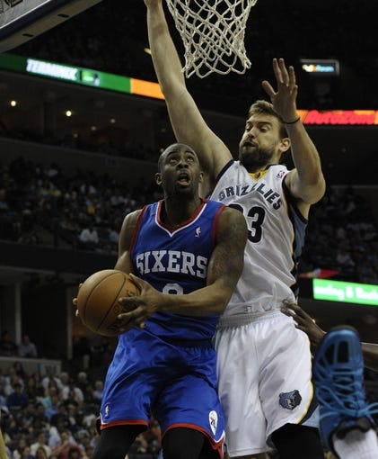 Apr 11, 2014; Memphis, TN, USA; Philadelphia 76ers guard James Anderson (9) lays the ball up against Memphis Grizzlies center Marc Gasol (33) during the game at FedExForum. Memphis Grizzlies beat Philadelphia 76ers 117 - 95. Mandatory Credit: Justin Ford-USA TODAY Sports